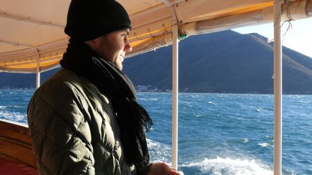 Tourist guy traveling on a boat in Adriatic sea. Professional shot  024.