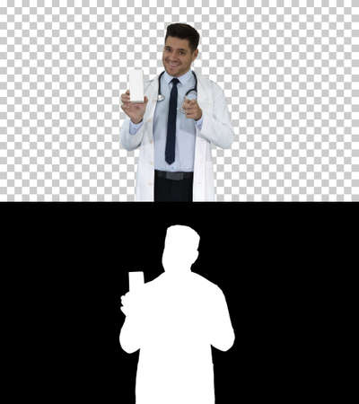 Confident Doctor Smiling and Presenting in Hand New Treatment, Alpha Channel Stock Photo