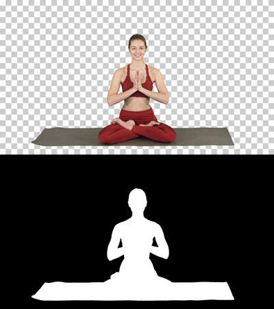 Smiling woman yoga meditating sitting lotus, hands coupled, Alpha Channel