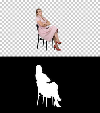 Woman in pink dress sitting on a chair waiting for someone, Alpha Channel