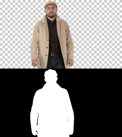 Fashionable man with dark beard in trench coat walking, Alpha Channel