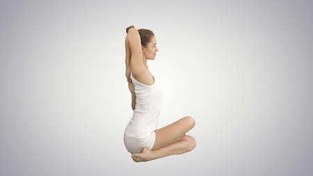 Yoga or pilates exercise without mat Gomukasana, Cow Face pose on gradient background.