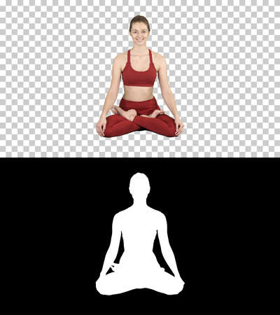 Young smiling woman practicing yoga, doing Padmasana exercise, Lotus pose, Alpha Channel