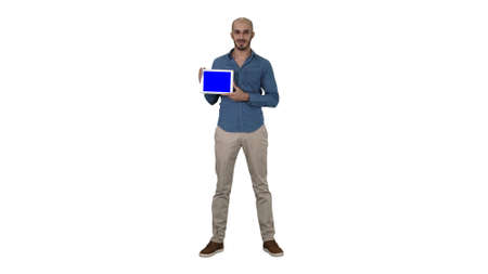 Smiling casual man presenting a tablet with a blank screen on white background. Zdjęcie Seryjne
