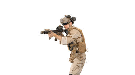 Soldier aiming with an assault rifle on white background.