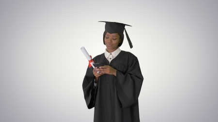 Happy African American female graduate holding diploma and texti
