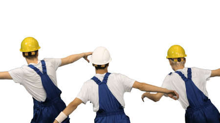 Three male construction workers in hard hats synch dancing with