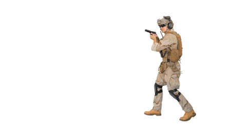 Soldier walking aiming with a pistol and shooting to camera on w Banque d'images