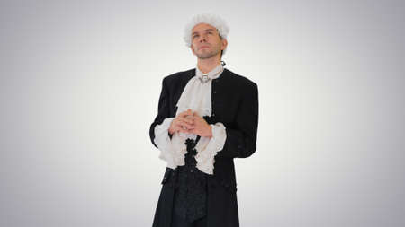 Man dressed in courtier frock coat and white wig thinking and fi
