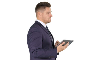 Young businessman touching digital tablet and checking object in