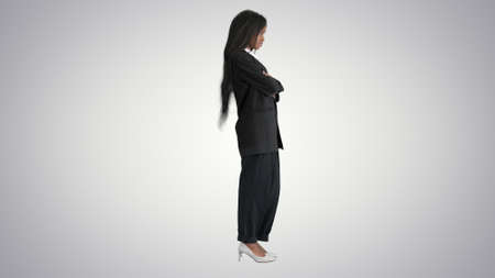 Confident african american businesswoman with crossed arms on gr