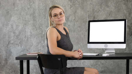 Proud freelance woman posing at office and looking at you. View Stock fotó
