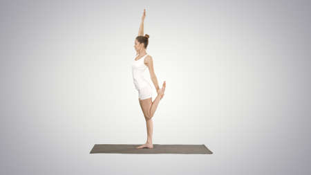 Young yogi attractive woman practicing yoga concept, standing in