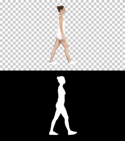 Young woman in sportswear taking a walk looking down, Alpha Chan