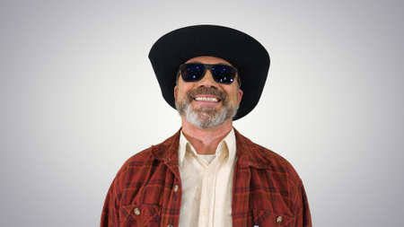 Ranger in a cowboy hat putting on sunglasses and smiling to came Reklamní fotografie