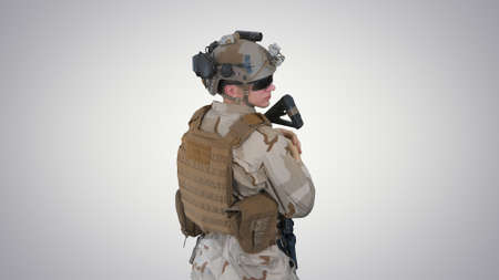 Fully Equipped Solder Holding Assault Rifle and Standing looking Reklamní fotografie