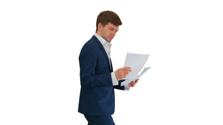 Serious Businessman reading documents or report while walking on