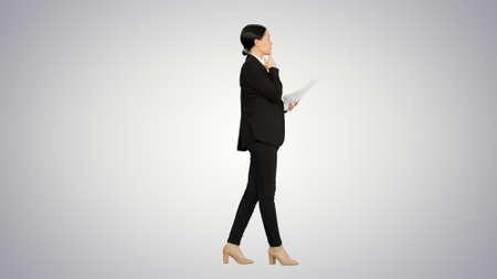 Serious Businesswoman reading report preparing for a presentatio