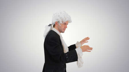 Man dressed like Mozart conducting while walking on gradient bac
