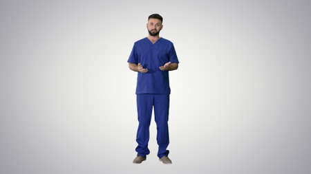 Male medical practitioner in a uniform talking explaining someth