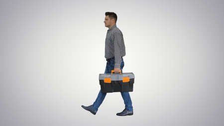 Professional repairman concept Handyman walking with tool case o