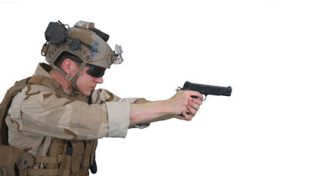 Soldier aiming and shooting with a pistol on white background.