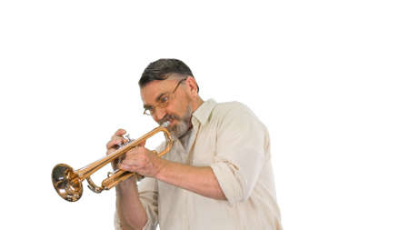 Old man in glasses playing trumpet on white background.