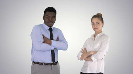 International business people standing with folded arms on gradi