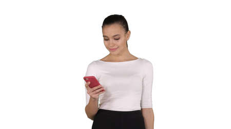 Happy young woman with smartphone making picture of her shopping