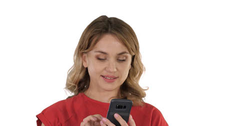 Thinking pretty blonde sending a text on her phone on white back