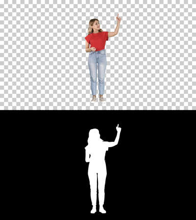 Smiling woman in casual clothes presenting something, pushing im Banque d'images