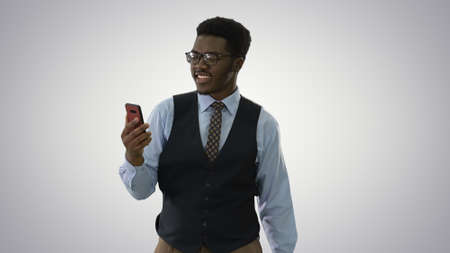 Smiling African American businessman making video call holding m
