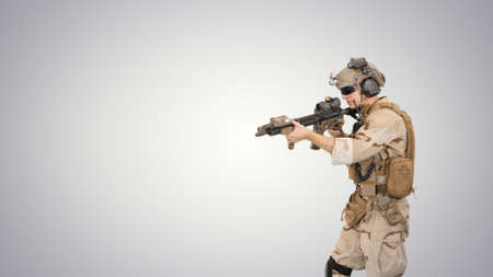 United states ranger walking in, making hold gesture and then ma