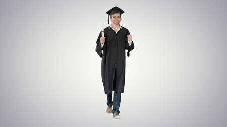 Happy graduation student walking to the graduation ceremony on g