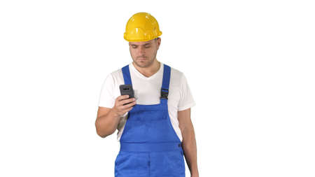 Factory worker employee chatting browsing texting on smartphone on white background.