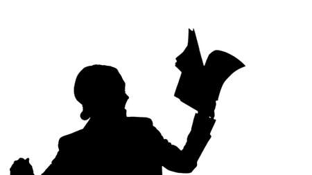 Silhouette Excited business woman dancing with a bunch of papers