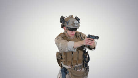 Army man pointing gun in multiple directions ready for combat on