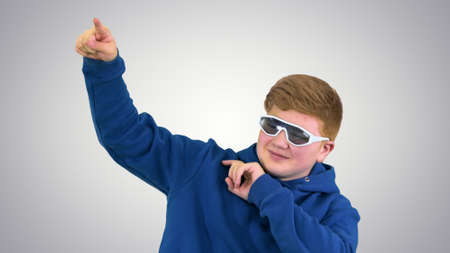 Teenager with sunglasses doing some cool dancing moves on gradie Stockfoto