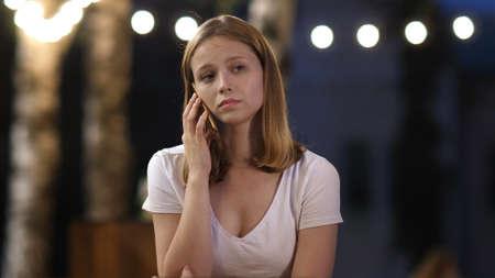 Upset girl talking on the phone.