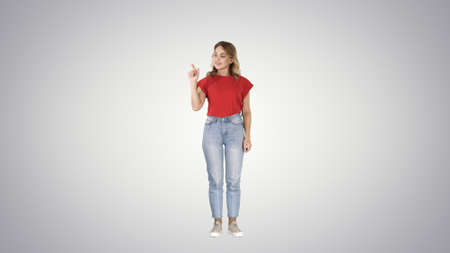 Casual charming woman presenter puching imaginary button on imag