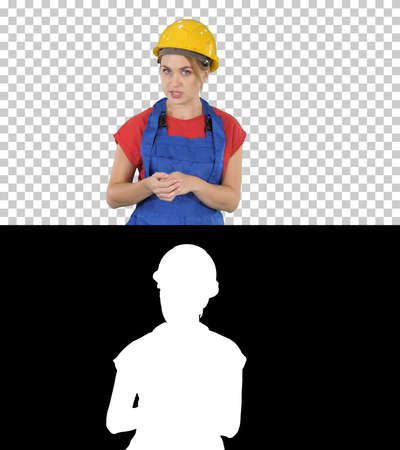 Construction female worket explaining her ideas to camera, Alpha