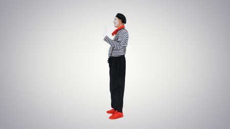 Mime walking through the imaginary door on gradient background.