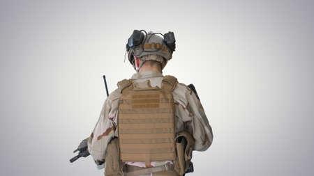 Ranger in combat uniform walking on gradient background.