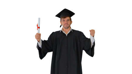 Male student in graduation robe posing with his diploma making f 版權商用圖片