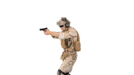 Soldier walking and aiming with a pistol on white background. 版權商用圖片