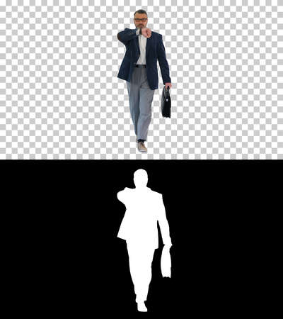Mature businessman walking in a hurry and looking at watch, Alph