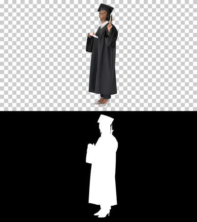 Smiling African American female student in graduation robe posin