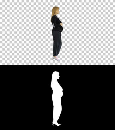 Pretty blonde woman standing with arms crossed, Alpha Channel wi