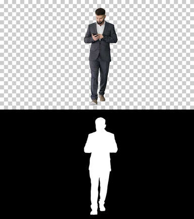 Businessman walking and using the phone, Alpha Channel with Silh 版權商用圖片