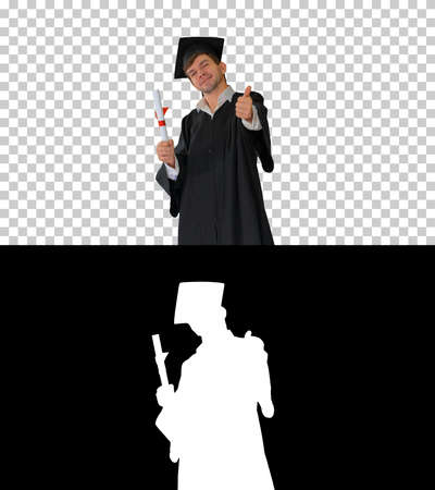 Happy male student in graduation robe posing with his diploma an